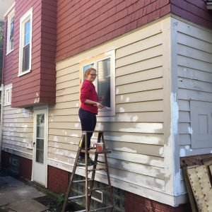Councilmember Lupien lending a hand in painting the side of the house!
